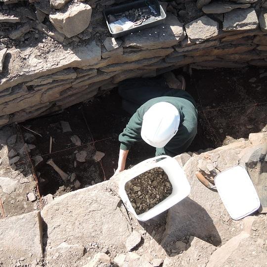 Paul excavating animal bones inside the souterrain passage