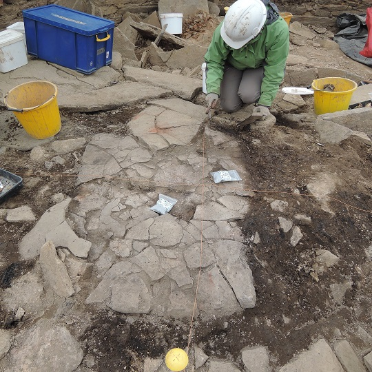 The large heat affected haerth base in the broch under excavation today