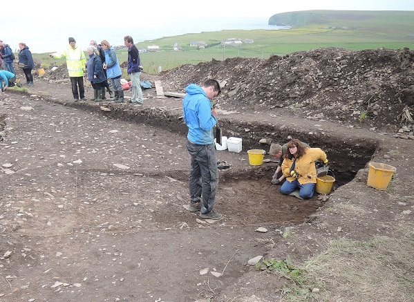 Visitors are taken on a tour on open day, while in the foreground the team excavated a section of the ditch
