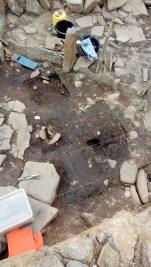 Floor deposits carefully gridded out under excavation inside the broch