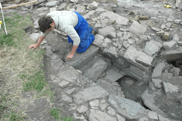 Remains of stairs within the walls of Structure A under excavation