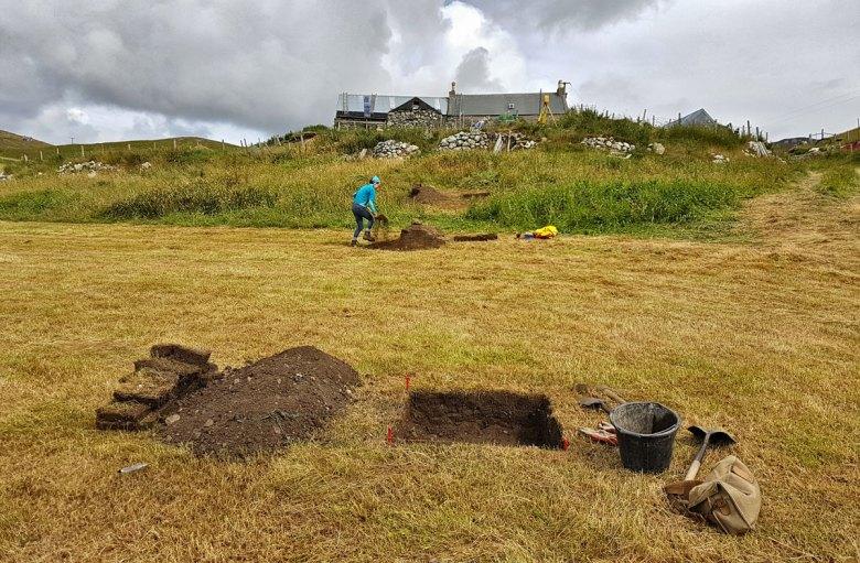 Linda digging a test pit. (Dan Lee).