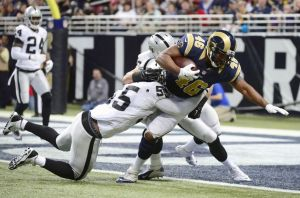Cory Harkey scoring his only touchdown of the 2014 season against the Oakland Raiders. Photo by Jeff Curry.
