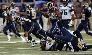 The Rams defensive line starts to celebrate after tackling Marshawn Lynch in the backfield to end the game.