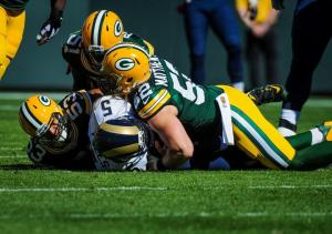 Nick Foles being sacked by a trio of Packers. Photo via Getty Images.