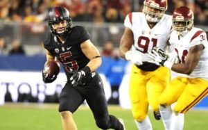 Stanford's Christian McCaffrey runs by USC during the Pac-12 title game. Photo via Kirby Lee/USA TODAY Sports.