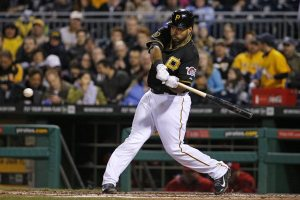 Pittsburgh Pirates' Pedro Alvarez (24) connects with a pitch from St. Louis Cardinals starting pitcher Shelby Miller for a solo-home run during the fourth inning of a baseball game in Pittsburgh Friday, April 4, 2014. It was Alvarez's second homer of the game. (AP Photo/Gene J. Puskar)