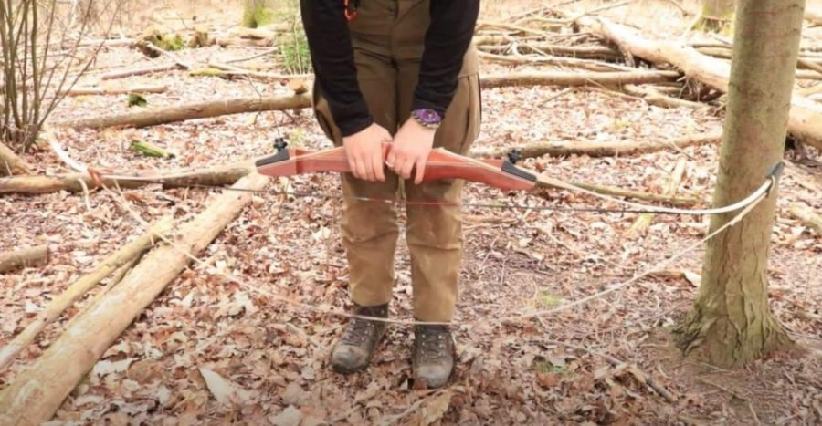 how to string a recurve bow place the bow horizontally