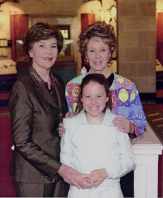 Kathryn Maegli Davis meets Laura Bush at the White House after presenting her with a Fabergé egg she created. Her granddaughter, Kathryn Maegli, joined her at the event honoring the artists who created each state's egg.