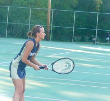 Photo by DENISE SEYFER Freshman Andrea Monacelli plays a singles match against MSOE at Hart Park on Oct. 1. The Mount Mary team won the event, 6-3.