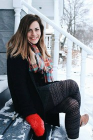 Lauren Wiech takes time to relax outside her home after a snowfall.