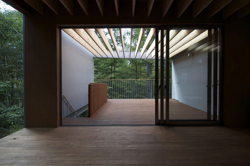 Interior view to courtyard - Pilotis in a Forest House / Go Hasegawa