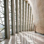The sunlight entering the Curved Galleries is cut by the exterior ceramic louvers.