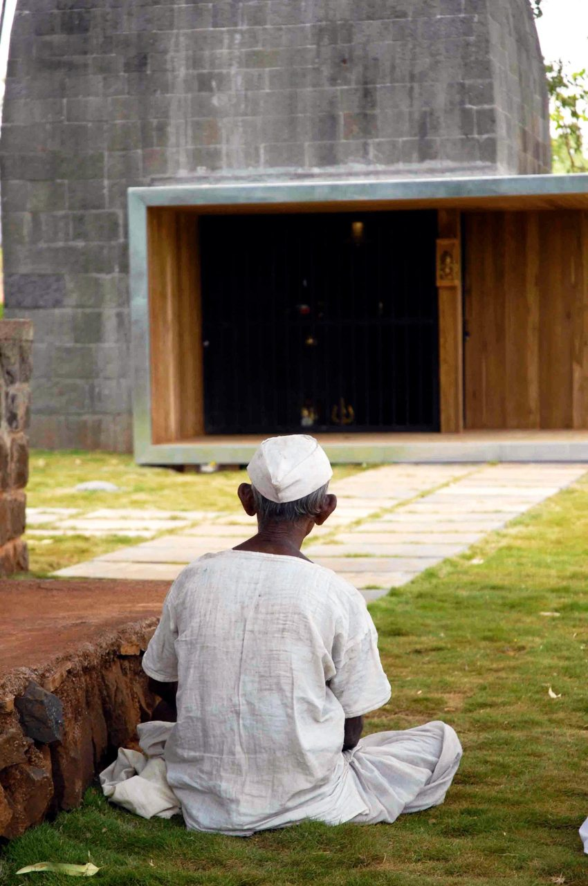 Person praying in front of the temple