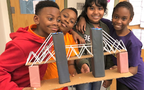 4 young friends sharing their bridge model project