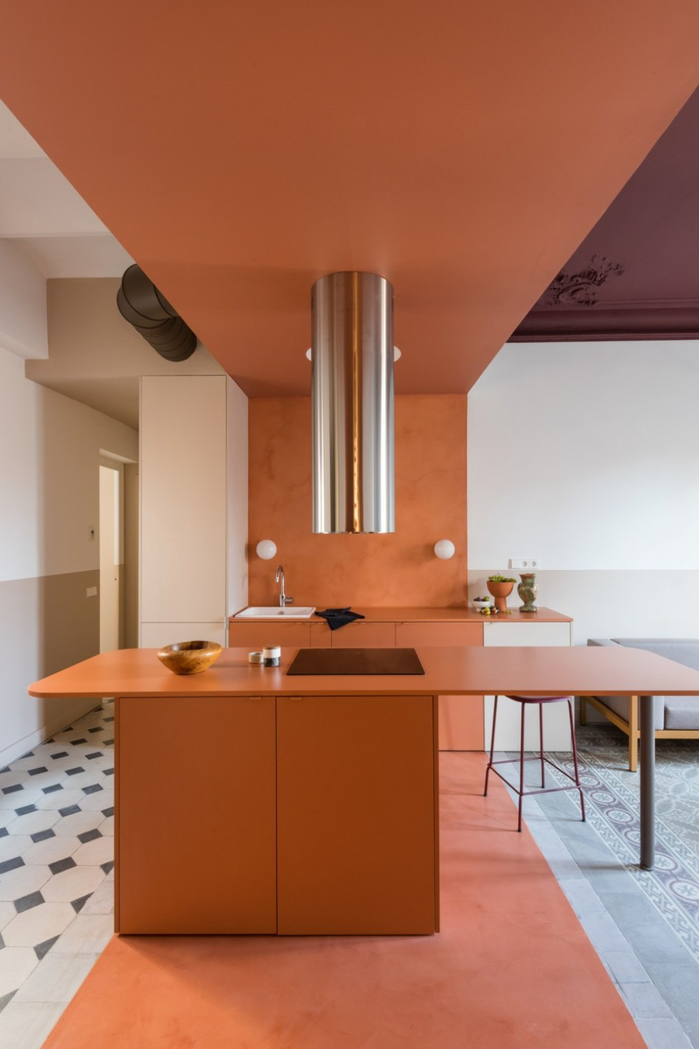 pAfter Microcement on the floors and backsplash match a terracotta stripe on the kitchen ceiling making for an a...