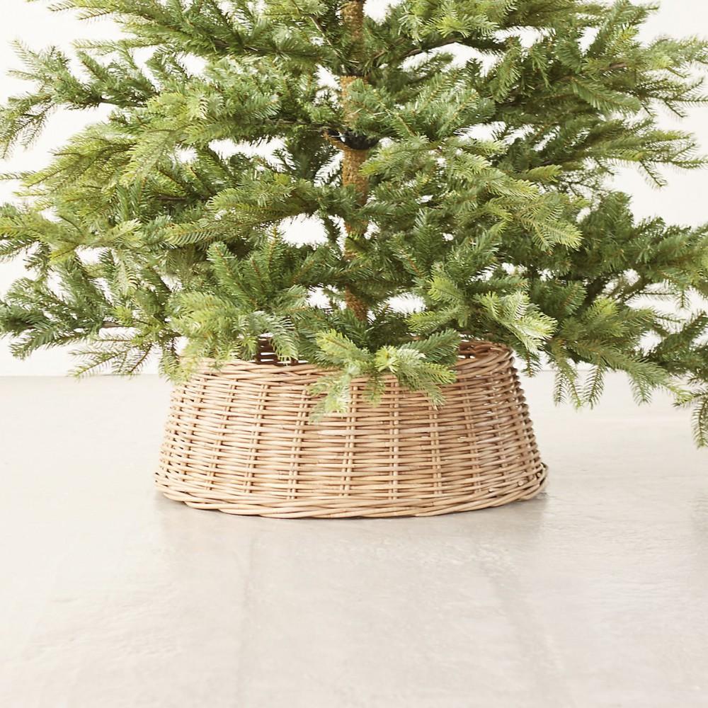 round wicker basket with Christmas tree inside