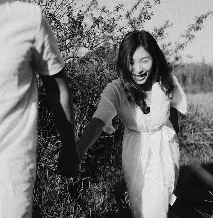 happy asian woman walking with boyfriend in countryside