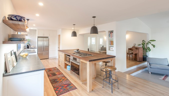Once highly segmented, the new open plan kitchen is now the home's main gathering place.