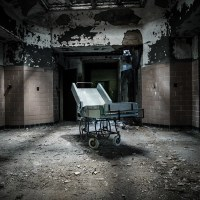 A Dark and Deserted Asylum Sits Quietly Falling to Pieces