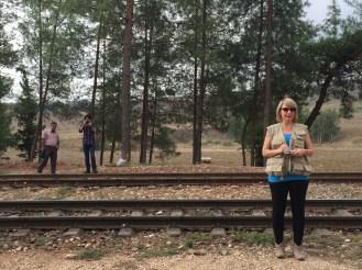 Graduate student Alana Wolf-Johnson takes site measurements at Durak station.