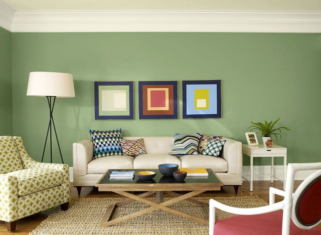 Green Living Room Green Wall White Ceiling Framed Pictures Down Light White Side Table Red Chair Coffee Table Ornamented Cushion Wooden Floor Carpet Gray Sofa Ornamented Sofa Modern Living Room
