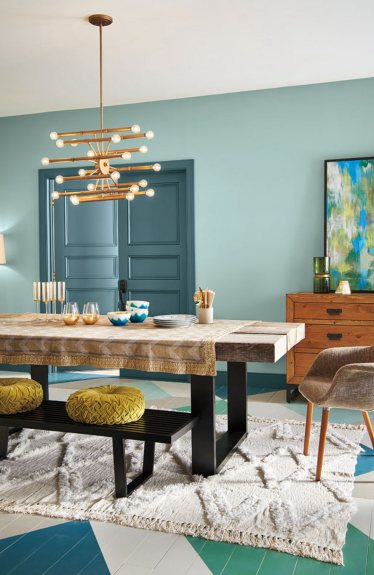 Soft aqua walls are layered with ‭deep blue-green trim, modern furnishings ‭and sparkling gold accents.