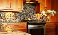 The Wall Of The Boulder With A Black Color For Warm And Enjoyable Kitchen
