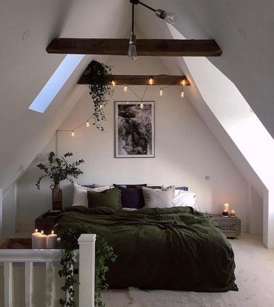 Cozy String Lights And Candles To Add More Light To This Attic Bedroom