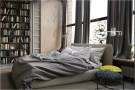 Large Window Industrial Bedroom With High Bookshelf