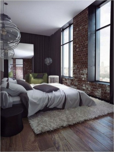 Large Window With Exposed Brick Industrial Bedroom Design