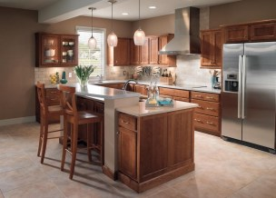 Minimalist Kitchen Using Brown Wood Starmark Cabinets With Stainless Steel Vent Hood