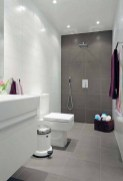 Simple Bathroom With A Design That Looks Spacious, With A Combination Of Two Colors Of The Wall