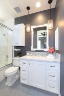 Small Bathroom Uncluttered Color Scheme In Dark Gray And White With Cabinet Sink