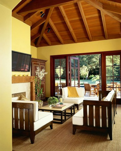 Yellow Rustic Living Room With Exposed Beam Ceiling
