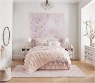 Pink Bedroom With Carpet And Wall Decorations