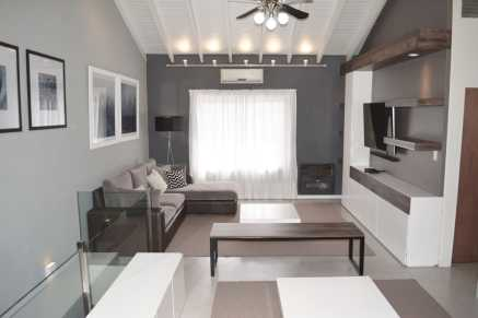 Appropriate Furniture for Unique Ceiling Design with Wooden Beams