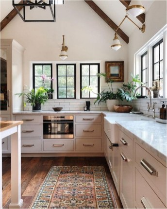 Wood Beams Ceiling With White Kitchen Set