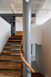 Akshat Bhatt - Architecture DisciplineB23 D- Exquisite Dissonance, the white and grey is punctuated with the warmth of teak wood staircases and handrails(1)