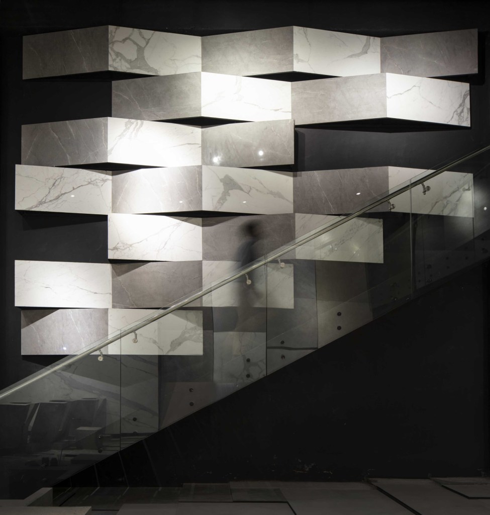MOFA Studio creates a theatrical monochromatic space for a tile showroom in Gurgaon 6