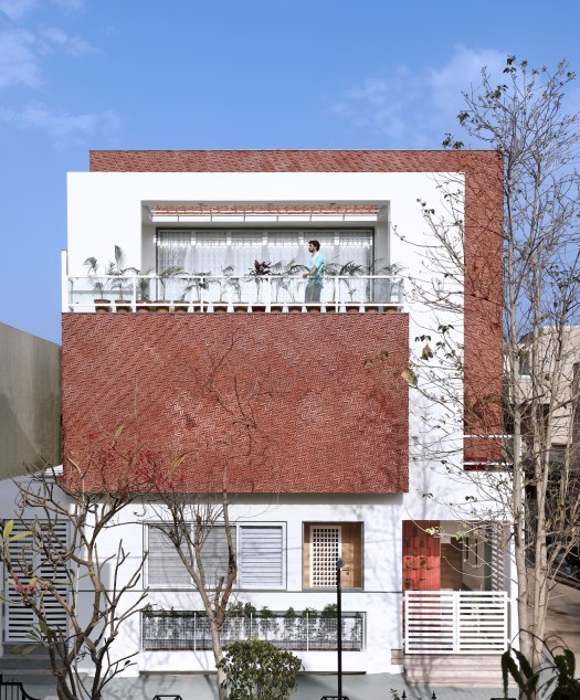 Manoj Patel Design Studio creates an innovative earthy red colored clay tile cladding facade for a refurbished residence in Vadodara 204