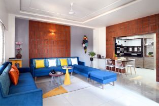 Clay sculpture and Brick pattern set the scene of natural medium in this apartment design, at Vadodara, Gujarat, by Manoj Patel Design Studio