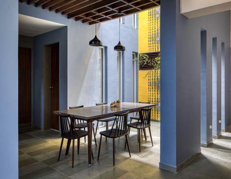 Clay roof tiles façade to minimize heat gain and has decorative function, at Vadodara, by Manoj Patel Design Studio 43