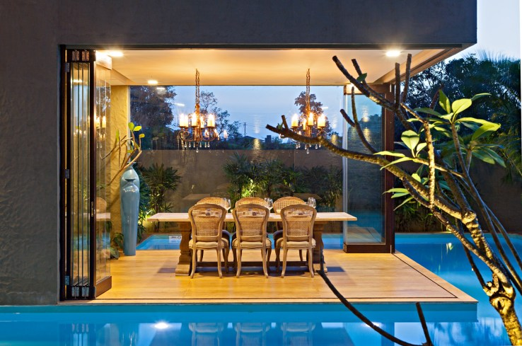139626531662706 The Dining Room suspends over the private pool giving the room an island like feel the tree in the dining area adds an element of surprise