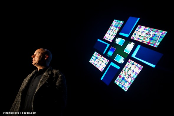 Brian Eno in front of his audio-visual artwork '77 Million Paintings'