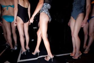 Models wearing Seventh Wonderland prepare to walk the runway