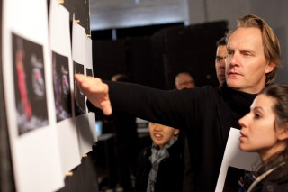 After the five models are shot mockups of the ad layouts are printed with their photo in it. Here photographer Stephen Ward surveys the images determining whose photo is best.