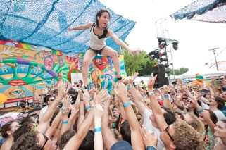 Kim from Matt and Kim surfs the Lilyworld crowd