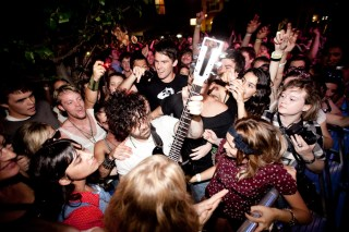 Foals frontman Yannis Philippakis plays in the crowd