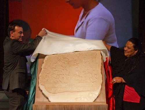 West Valley City Mayor Michael Winder and Rhosby Barker of Casa Chiapas unveil a replica of Izapa Stela 5.